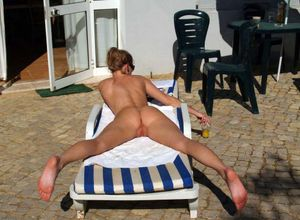 Sunbathing completely naked on a..