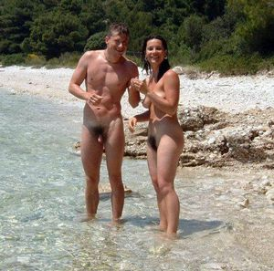 Naked Teens frolic on the beach