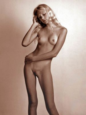 Long legged blonde cutie is naked.
