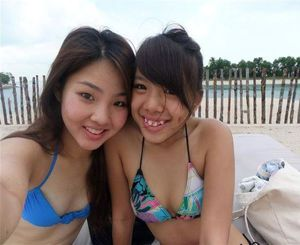 Little Japanese girlfriends on the beach