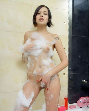 Her naked body was covered with foam,..