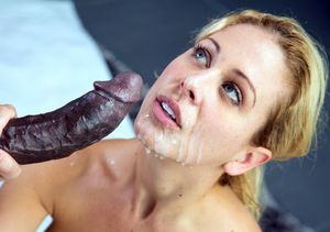 Blonde Cherie Deville is tasting the..