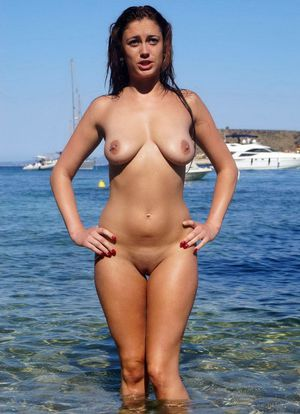 Several young nudists posing naked on..